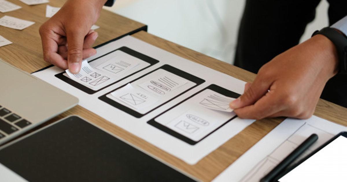A designer making a mobile responsive web design